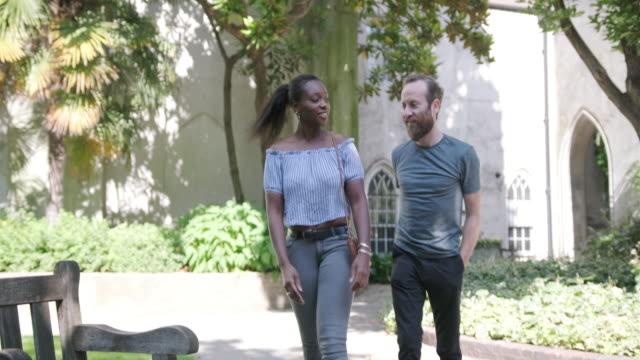 mature heterosexual couple walking aroundst dunstan in the east in london - bonding stock videos & royalty-free footage
