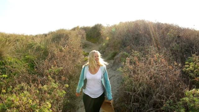 Mature hiker explores shoreline dunes