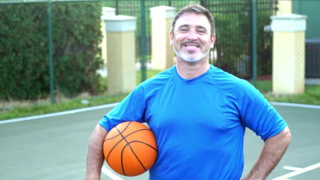 mature hispanic man on basketball court - hand on hip stock videos & royalty-free footage