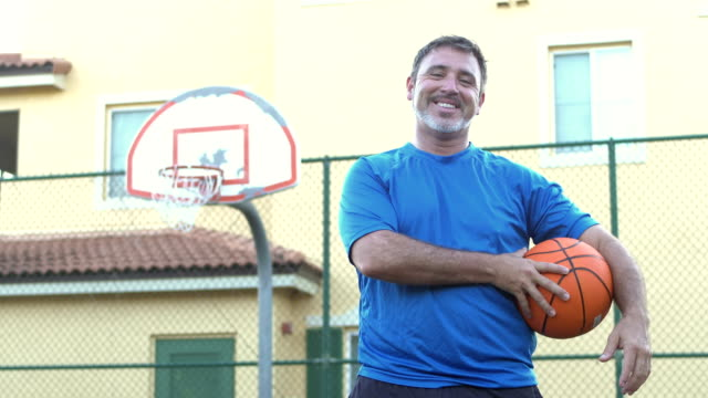 Mature Hispanic man on basketball court