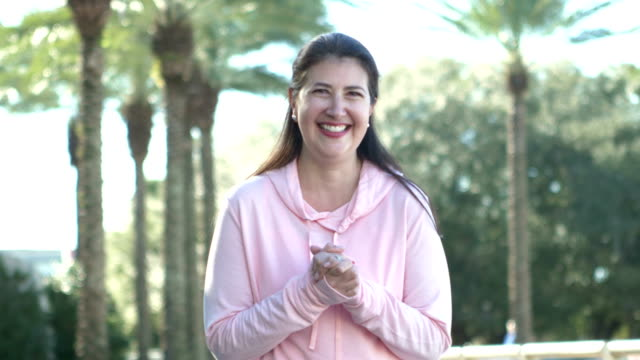 mature hispanic woman wearing hooded sweatshirt - 50 54 years stock videos & royalty-free footage