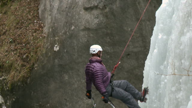 hd: mature ice climber - abseiling stock videos & royalty-free footage