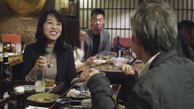 mature japanese woman enjoying at tokyo restaurant with colleagues - coworker stock videos & royalty-free footage