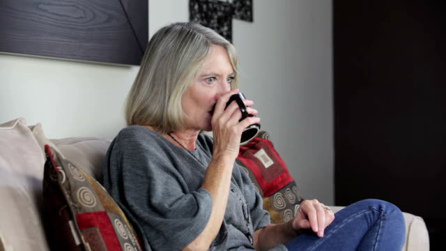 Mature lady enjoying a cup of coffee