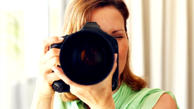 Mature lady using a digital camera