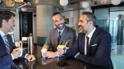 mature latin business people enjoying coffee break - argentinian ethnicity stock videos & royalty-free footage