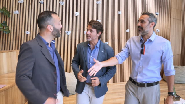 mature latin business people meet each other, handshake and exchange business cards - business casual stock videos & royalty-free footage
