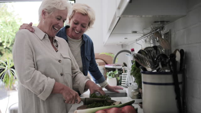 mature lesbian couple cooking a meal together at home - gay couple stock videos & royalty-free footage