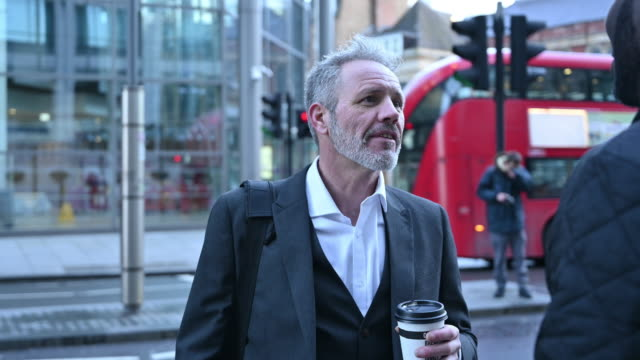 mature london businessmen talking outdoors with coffee - 30 seconds or greater stock videos & royalty-free footage