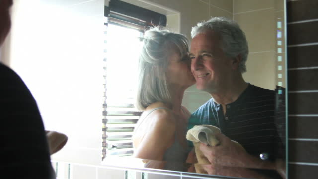 mature male and female in bathroom - falling in love stock videos & royalty-free footage