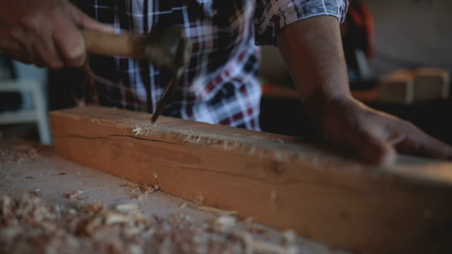 mature male hands of carpenter at work - timber stock videos and b-roll footage