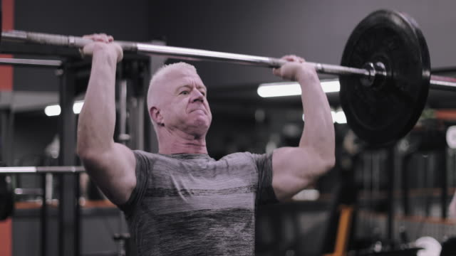 mature male weightlifter at the gym - picking up stock videos & royalty-free footage