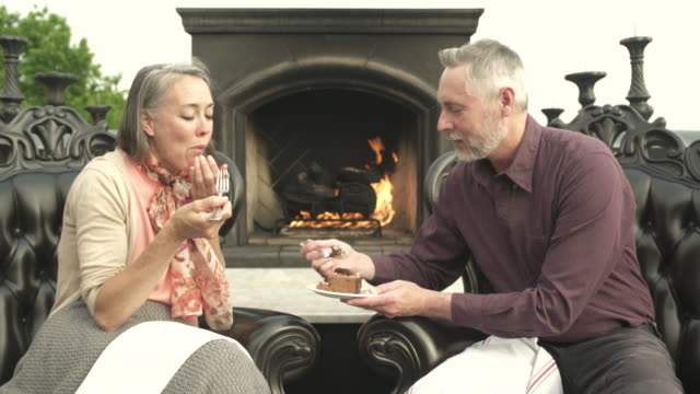 mature man and a mature woman sharing a cake - dessert stock videos & royalty-free footage