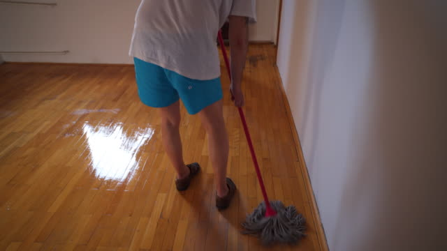 mature man at home mopping up freshly painted room stock video - freshly painted stock videos & royalty-free footage