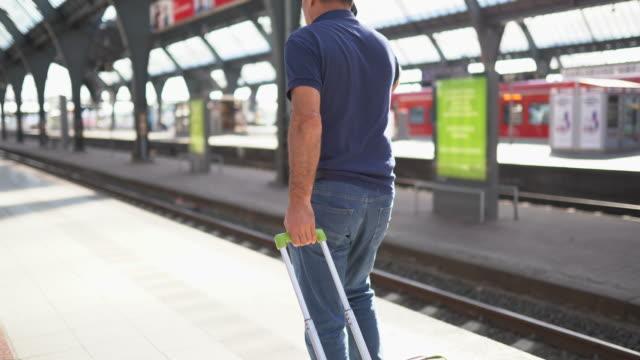 mature man at the train station - railway station platform stock videos & royalty-free footage