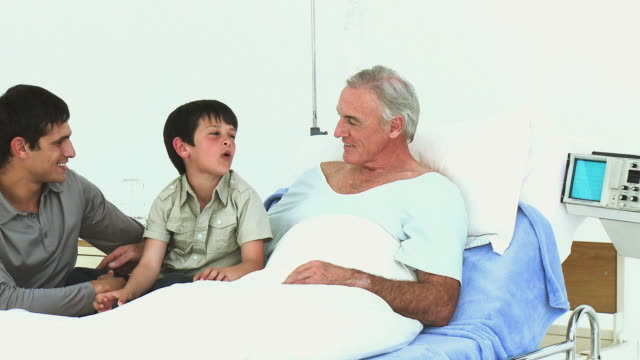 ms mature man being visited by son and grandson (8-9) in hospital / cape town, south africa - see other clips from this shoot 1796 stock videos & royalty-free footage