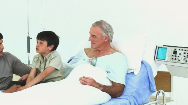 ms pan mature man being visited by son and grandson (8-9) in hospital / cape town, south africa - see other clips from this shoot 1796 stock videos & royalty-free footage