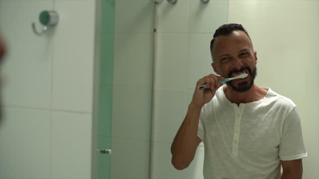 mature man brushing teeth at home - only mature men stock videos & royalty-free footage