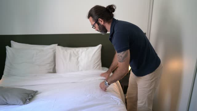 mature man doing bed in the morning at home - bedroom stock videos & royalty-free footage