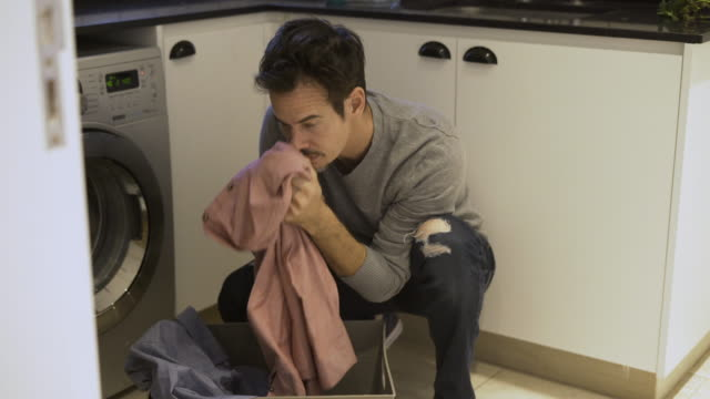 mature man doing laundry - washing stock videos & royalty-free footage