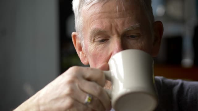 mature man drinking coffee - only mature men stock videos & royalty-free footage