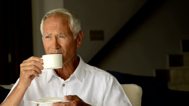 mature man drinking coffee - white shirt stock videos & royalty-free footage