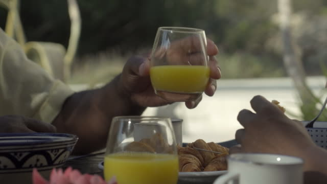 a mature man drinks orange juice - orangensaft stock-videos und b-roll-filmmaterial