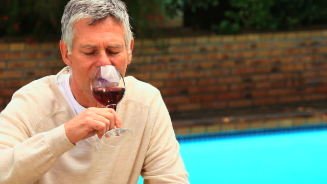 mature man enjoying a glass of red wine / cape town, western cape, south africa - only mature men stock videos & royalty-free footage