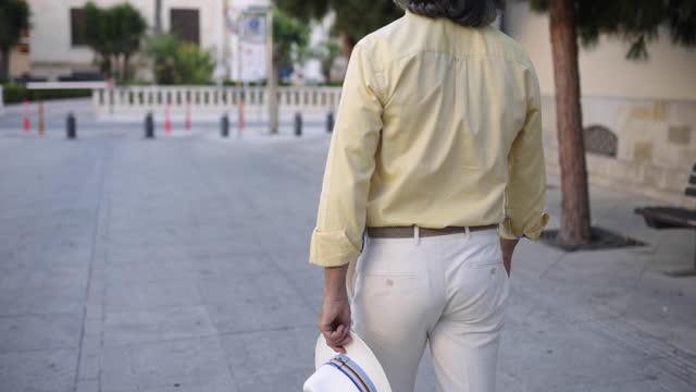 mature man enjoying the walk and exploring the city during vacation - grey hair stock videos & royalty-free footage