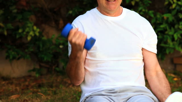 mature man exercising his arms / cape town, western cape, south africa - only mature men stock videos & royalty-free footage