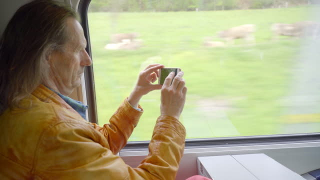 mature man filming the swiss countryside - only mature men stock videos & royalty-free footage