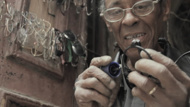 cu mature man fixing sunglasses / havana, cuba - only mature men stock videos & royalty-free footage