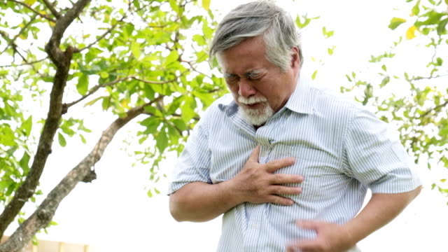 mature man having heart attack - pain stock videos & royalty-free footage