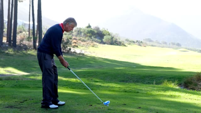 mature man hitting a golf shot - golfer stock videos and b-roll footage