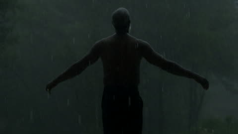 mature man holds his arms out in the rain (medium) - despair stock videos & royalty-free footage