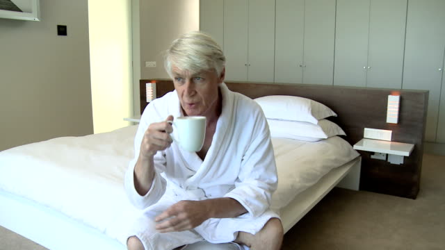mature man in bedroom with a cup of coffee - florida south africa stock videos & royalty-free footage