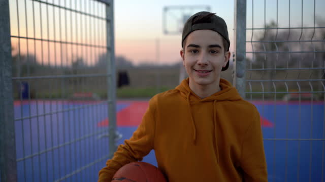 mature man in front of outdoor basketball court - teenage boys stock videos & royalty-free footage