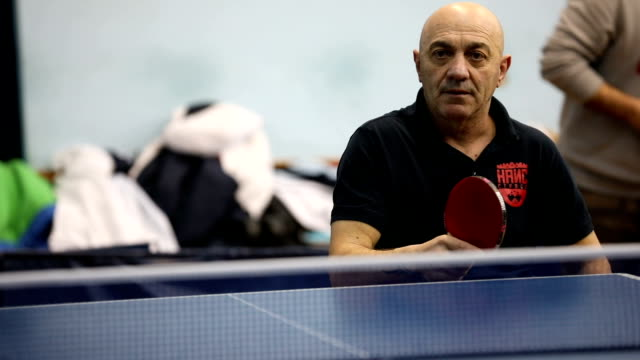 mature man in wheelchair playing table tennis - table tennis stock videos & royalty-free footage