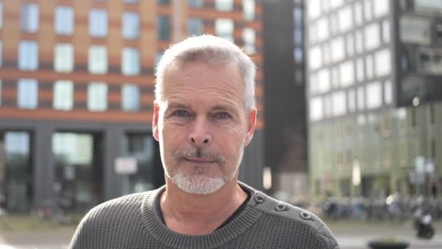 mature man looking at the camera - headshot stock videos & royalty-free footage
