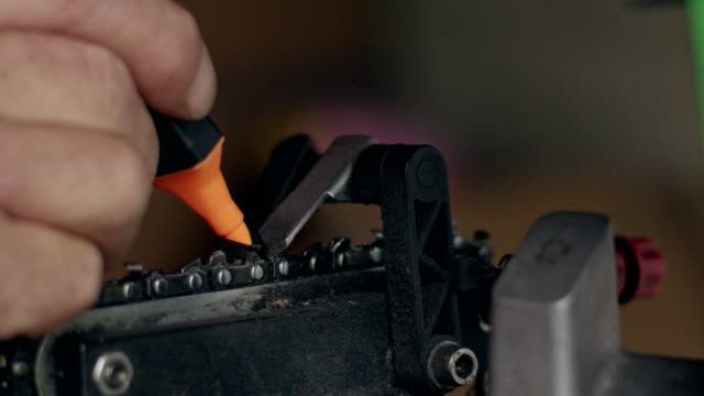 mature man marking chain length with felt tip pen - chainsaw stock videos & royalty-free footage