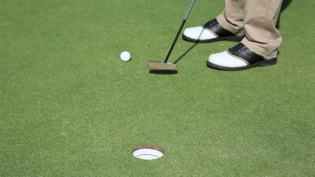 mature man playing golf, low section - golf shoe stock videos & royalty-free footage