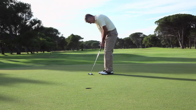mature man playing golf on golf course - punching the air stock videos & royalty-free footage
