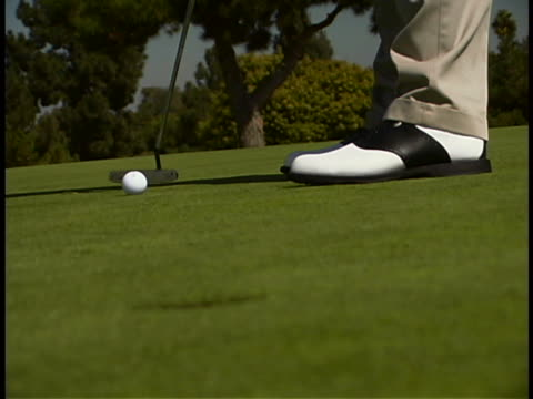 mature man playing golf - golf shoe stock videos & royalty-free footage