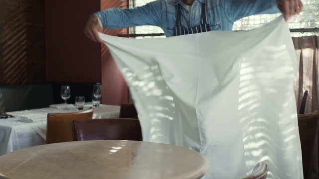 mature man putting tablecloth on restaurant table - 45 49 years stock videos & royalty-free footage