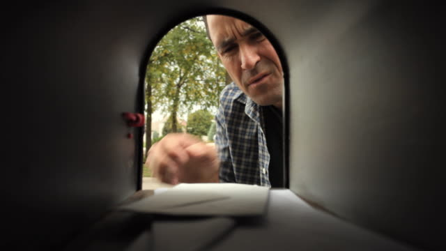 cu mature man retrieves mail from mailbox / neenah, wisconsin, usa - mailbox stock videos and b-roll footage