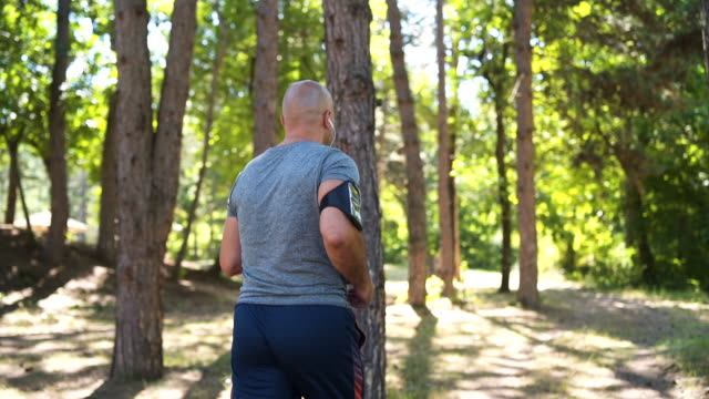 mature man running in forest - 50 54 years stock videos & royalty-free footage