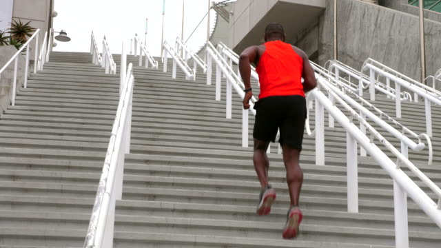 ms mature man running stairs during morning workout - one man only stock videos & royalty-free footage