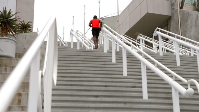 ws mature man running stairs during morning workout - one man only stock videos & royalty-free footage