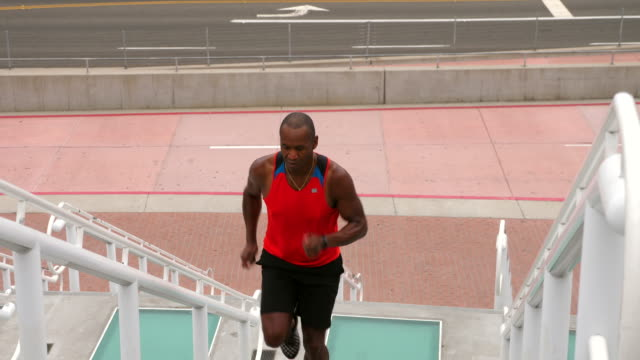 ts mature man running stairs during morning workout - one man only stock videos & royalty-free footage