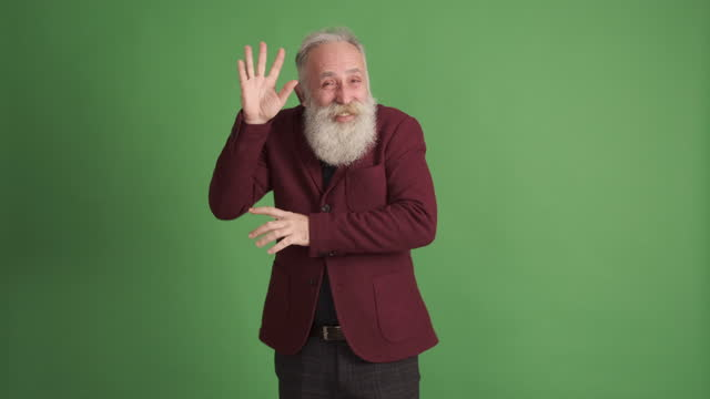 mature man  smiling and dancing. green background. one person - senior men stock videos & royalty-free footage
